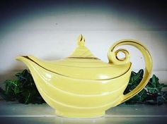 Hall Aladdin Style teapot. Made by: Hall Circa: 1940's  Beautifully crafted by; Hall this teapot would make a great addition to a collection, or to display around your home. Minimal crazing very sleek handle and body on this teapot; one of my favorites. With the different seasons this would even be a great teapot to up-cycle and put a flower arrangement inside. There is some noted wearing on the gold painted areas, a small spot inside the teapot, and some surface wear to the bottom of the…
