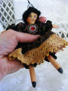 Handmade doll ornament.