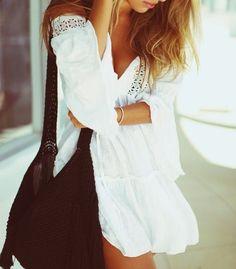 I love flowy white dresses for a summer wardrobe staple