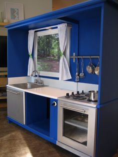 Modern 'stainless steel' play kitchen from an old entertainment center - complete with a scenic window view!