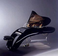 Melting piano! The hand-made Schimmel Pegasus has an ergonomically curved keyboard, over 200 strings under a total tension of 176,520 newtons, and a key assembly composed of 10,000 pieces. Only 14 were made ten years ago for people like Eddie Murphy, Lenny Kravitz and Prince.