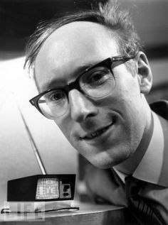 Mini Television, 1966.  British inventor Clive Sinclair shows off his mini television. Please note the thickness of his glasses.