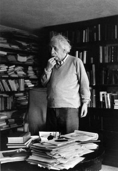German born physicist who formulated the theories of relativity, Albert Einstein - ponders a problem in his paper-filled study in Princeton, New Jersey. A Nobel prize-winner for Physics in Original Publication: In black and white book Theory Of Relativity, E Mc2, Physicist, Belle Photo, New Jersey, Black And White Photography, Old Photos, Rare Photos, South Beach