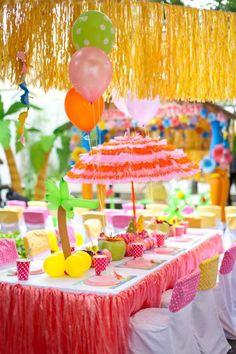 Luau party.  Grass skirt ($1.00) paper umbrella, balloons, etc. - Dollar Tree has tons of Luau supplies.