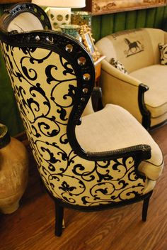 Beautifully detailed black antique wing chair