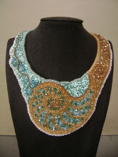 Nautilus design in crystal and glass beads for the needlework division of the show by Nancy Goes.