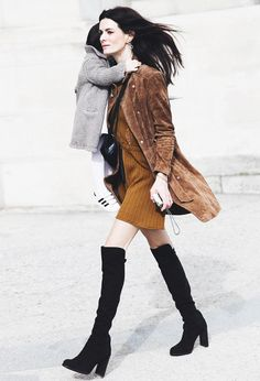 A lace top, ribbed skirt, and suede jacket are worn with knee-high suede boots