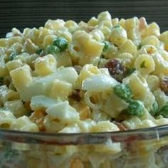 This is a wonderful cold pasta salad with ham, hard cooked eggs, Swiss cheese, and peas. Tossed with a creamy, spicy dressing, this salad is also great with macaroni, rotini, or your favorite shaped pasta.