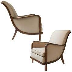 Swedish Art Deco armchairs with scroll back.  Sweden  1930  Elegant pair of Swedish art deco armchairs with a graceful scroll backs raised on sabre back legs. The chairs are solid stained birch and feature a cantilevered platform seat with upholstered cushion.