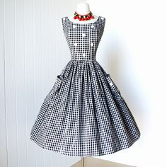 vintage 1950's dress ...classic BLACK & WHITE GINGHAM cotton full skirt pin-up sun dress with metal beaded appliques and huge pockets l xl. $140.00, via Etsy.