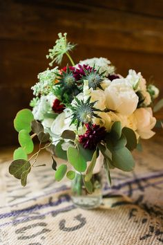 Red, ivory, and green bridal bouquet | Magnolia Adam's Photography | see more at…