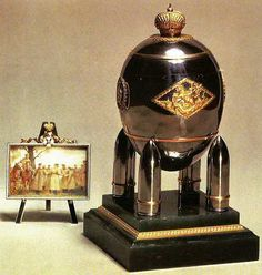 The 1916 Steel Military Egg, presented by Nicholas II to Empress Alexandra Feodorovna. The surprise was a miniature of Tsar Nicholas and his son Alexei at the war front. At the top of the easel is the ribbon and badge of the order of St. George.