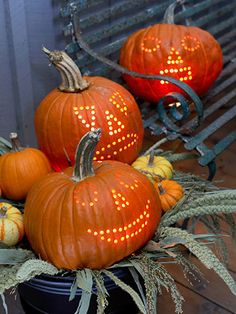 Powered-Up Pumpkins  --  Whip out the power drill to carve intricately detailed pumpkins. These faces were sketched first, then a power drilled to make evenly spaced holes along the drawn lines.
