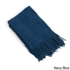 Keep yourself warm at home with the knitted zigzag design throw blanket. Machine washable for easy care and repeated use, this cozy throw is available in navy blue, rose, shitake and vanilla.