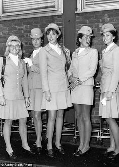 Glamorous Pan Am air hostesses in the 70s stood out in airports with their bright blue uni...