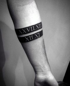 Gentleman With Black Band Roman Numerals Forearm Tattoo