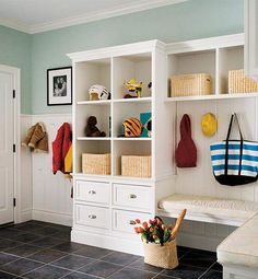 Built-in storage is always a smart move: Cupboards and drawers can hide some of the mess. But cubbyholes and open spaces need systems — here, a series of baskets and hooks help to rein things in. MORE FILIPACCHI BOOKS: Decorate