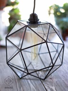 """Keppler Snub Cube Large Chandelier with Vintage Bulb Lamp in minimalistic interior. . Let we gladly introduce to you our first lamp with a retro bulb  """"a snub cube""""  the name of this figure was given by Johann Kepler in the treatise of 1619 """"Harmony of the world""""  #stereometricdesign #interiorlight #retrolamp #tiffany #art #kaluga #designlight #snubcube #vintage #retro #art #uv #portret #oil #canvas #chandelier #glasslamp #glasswork #bulb #geometry #fixturelamp #etsy #minimalistic"""