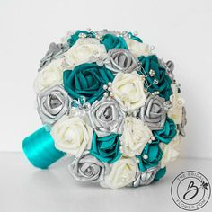 Items similar to Teal wedding bouquet, teal and silver bridal bouquet, alternative wedding bouquet with crystals and pearls, faux flower bouquet, foam roses on Etsy Teal Wedding Bouquet, Teal Bouquet, Teal Wedding Flowers, Teal Wedding Cakes, Bridal Bouquets, Teal Flowers, Prom Flowers, Silver Wedding Decorations, Wedding Themes