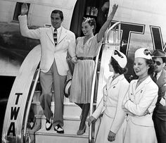 Tyrone Power and Paulette Goddard descend from the Stratoliner on its arrival at La Guardia Airport. They were among several Hollywood celebrities who made the first flight from West to East, August 1940