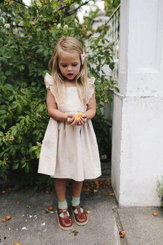 The Wren & James linen pinafore dress in Natural.