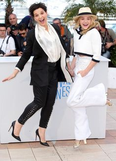 Juliette Binoche and Chloë Grace Moretz jump for joy at Cannes.