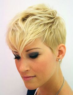 Wild Pixie Haircut. The bangs running in a long layer through the middle. Short back with long pointy sideburns. You can wear the bangs upwards or to the side too. ✂