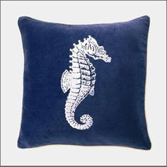 Seahorse Pillow. Crisp and classic. The classic, traditional Hamptons beach house blue is found in our velvet pillow. The seahorse has been embroidered in white silk thread for added elegance, sheen and softness.