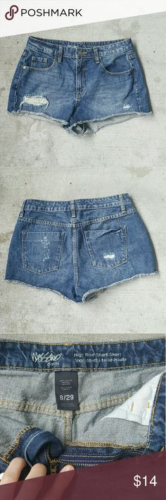 Distressed dark blue denim jean shorts high rise Distressed, ripped dark blue denim jean short shorts. High rise, high waisted style. Pockets in front and back. Brand new, nwot! No flaws, perfect pair of pants for the summer!! Brand is Mossimo, size 8, waist 29 inches.  Offers welcomed :) Mossimo Supply Co. Shorts Jean Shorts