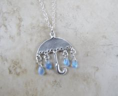 Umbrella with raindrops necklace, etsy - so cute