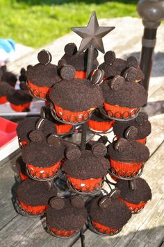 Mickey Cupcakes I made for Riley's Bday party.    You make boxed cupcakes.   Frost them with chocolate icing.  Grind up 1/2 pack of oreos (w/ icing)  Roll the cupcake tops in the oreo.  Put 2 toothpicks in mini oreos and put them on as ears.