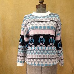 """Sweater Womens 1980s Tribal Graphic Long This sweater has great colors and pattern.   Details Size: unmarked Chest: 34"""" Shoulders: 18"""" Sleeve: 17"""" Length: 23"""" Waist: 30""""  Brand: La Vista Colors: Pale Pink, Grey Blue, Black, Turquoise & White Condition: Great, one hole on left shoulder."""