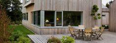 Cedertræet i facaden vil få en smuk patina, og er desuden næsten vedligeholdelsesfrit og meget formstabilt.\nFoto: Torben Nielsen