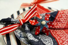 Red, White and Blue Wedding Ideas: Spice up your table setting with some red, white and blue bandana and pinwheel favors. It's an ideal backyard wedding addition!
