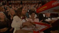 And even sacrificed his pizza for her: | The 27 Best Moments From The 2014 Academy Awards
