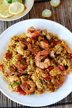 Spanish style rice dish - Mixed Paella with Chicken, Shrimp, Sausage, and Bell Peppers. Spiced up with smoked paprika, red chili powder and turmeric. I used to think that paella was a highly complicated dish Fish Recipes, Seafood Recipes, Mexican Food Recipes, Chicken Recipes, Dinner Recipes, Cooking Recipes, Healthy Recipes, Shrimp And Rice Recipes, Recipies