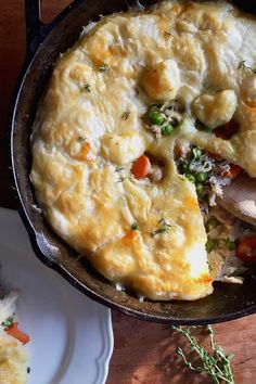 This family favourite is packed with roast chicken and vegetables, topped with a light puff pastry crust then baked until golden. Perfect for your next Saturday or Sunday night dinner, and it's on the healthier side too! #chickenpotpie #chickendinner #chickenrecipes #onepandinner #potpie #puffpastry #dairyfree #cozyfood #healthydinnerideas #comfortfood #castironrecipes #skilletmeals