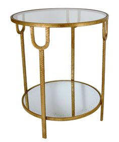 A Sophisticated, Sleek Round Side Table Featuring A Gilded Finish And Small  Decorative Details On