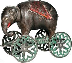 """Antique Pull Toy of the Most Famous Elephant in the World....""""JUMBO"""".  An African Elephant Purchased from the London Zoo by P.T. Barnum & Brought to America, Where He Lived a Mere 3 mos.  He was Hit by a Train & Died, BUT went on to Fame by Having His Name Associated With More Products than Any Other.  I Have an Antique Jar From None Other Than """"JUMBO"""" Peanut Butter.  He Was HUGE....and Even After His Death, He Was a Huge Success!"""