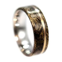 Three thin pinstripes of bronze surrounded by titanium make for a beautiful accent to the natural buckeye burl wood wedding band. The…