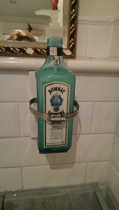 Recycled gin bottle in London coffee house. How novel!