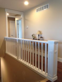 """This craftsman style balcony staircase has a custom contemporary handrail, flat panel newel post made of 3/4"""" S4S poplar and 1 1/4"""" contemporary balusters."""