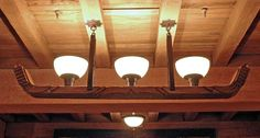 A carved wood light fixture in the Barlow Room of Timberline Lodge.