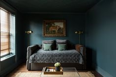 The sconces are from Savoy Lighting. The daybed is from Overstock. The tiger painting is vintage.