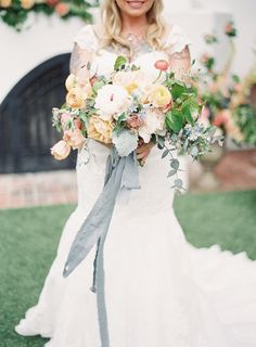 Lily, peony, lamb's ear, ranunculus wedding bouquet: Photography: Sposto Photography - www.spostophotography.com   Read More on SMP: http://www.stylemepretty.com/2016/10/28//
