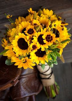 Bright sunflowers en masse make for a fall inspired bouquet that's sure to make you smile. Fall Wedding Bouquets, Floral Arrangements