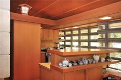 Buying a Frank Lloyd Wright original would be like trying to buy a priceless museum artifact.On Vashon you can live in a house inspired by his ideas for $374,000. Vashon Island, Usonian, Organic Architecture, Frank Lloyd Wright, Liquor Cabinet, Cottage, Museum, Inspired, The Originals