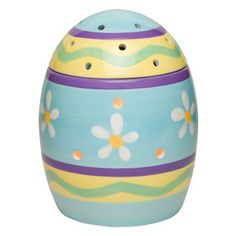 Easter Egg Full-Size Scentsy Warmer PREMIUM - As colorful as the coming spring, Easter Egg is the perfect present for any basket! Layers of pretty, hand-painted pastel patterns and dancing daisies decorate its glossy surface. Open it, and you'll find a clever treat a warmer dish nestled right into the egg.