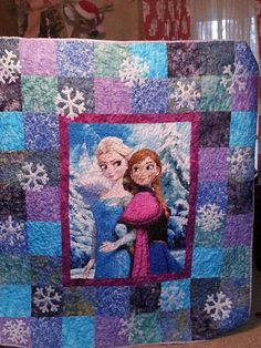 This frozen quilt is available now just for you. A frozen pannel surrounded by batik squares and raw edge applique snow flakes. The back is a pretty