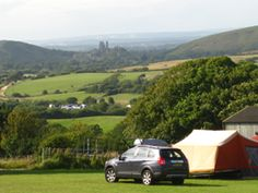 This farm is looking like a possible venue for a camping trip this year. View of the very beautiful Corfe Castle and rated second best campsite in Cool Camping England.